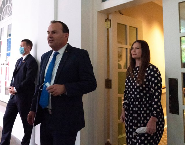 In this Saturday, Sept. 26, 2020, photo, Sen. Mike Lee, R-Utah, center, steps out of the West Wing to watch as President Donald Trump announces Judge Amy Coney Barrett as his nominee to the Supreme Court, in the Rose Garden at the White House in Washington.