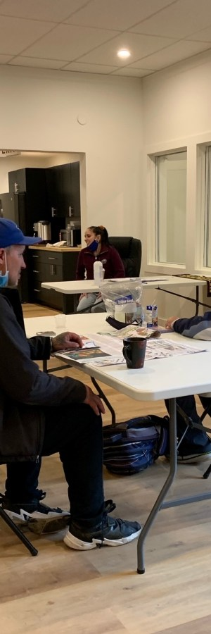 Two residents sit for a cup of coffee at the new Phoenix Learning Centre in Fredericton, N.B.