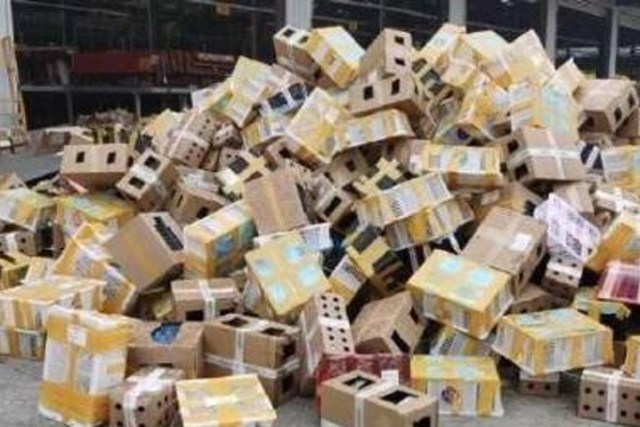 Cardboard boxes that housed thousands of pets are shown at a shipping depot in Luohe City, China, on Sept. 22, 2020.