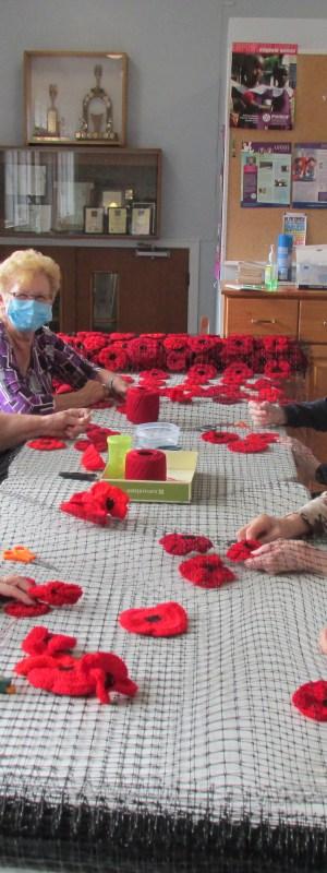 Oakwood Terrace Nursing Home volunteers work on Remembrance Day poppy display