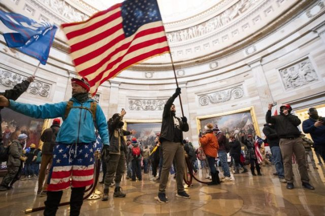 Supporters of US President Donald J. Trump in the Capitol Rotunda after breaching Capitol security in Washington, DC, USA, 06 January 2021.