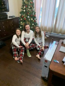 Lexi Dakin (right) is seen with two of her sisters. Submitted by Chris Daken