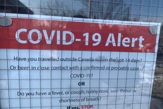 covid 19 alert school sign toronto coronavirus