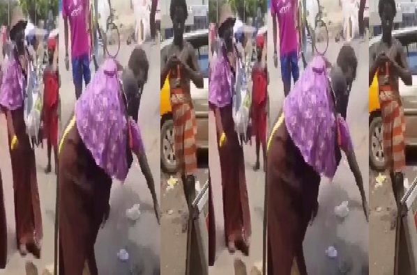 Pastor wrestles 'mad' woman for preventing him from taking street offertory (VIDEO)