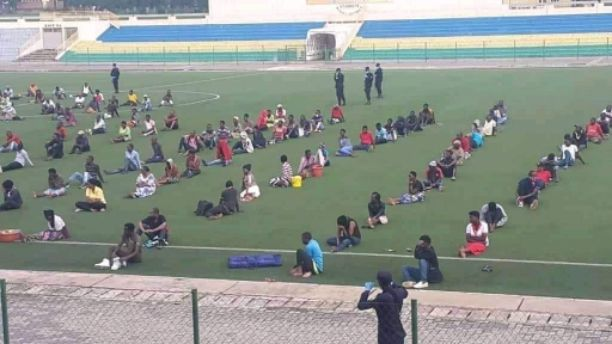 COVID-19: People who does not observing lockdown order in Rwanda, are taken to a stadium to sit all day (Photos)