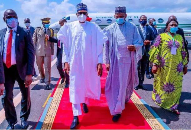 President Buhari spotted wearing face mask for the first time when arrived Mali (Photos)