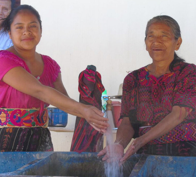 Two women in Quiejel, Guatemala, enjoying their new clean water.
