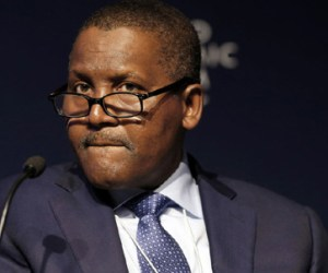 Aliko Dangote, billionaire and chief executive officer of the Dangote Group, pauses during a session at the World Economic Forum in Davos, Switzerland, on Jan. 22, 2015. Photo: Bloomberg