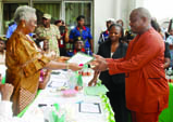INEC Supervisory Commissioner for Rivers, Cross River and Akwa Ibom, Mrs Iremiren Thelma (left), presenting Certificate of return to Rivers governor-elect, Mr Nyesom Wike in Port Harcourt, Rivers State on Monday