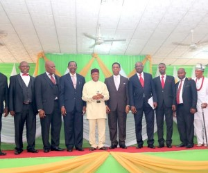 Governor, Theodore Orji (middle) flanked on both sides by > members of ASOPADEC and some other quests after receiving an > award as ''Epitome of Equity and Justice'' > in Umuahia.