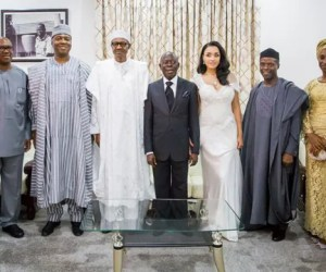 (L-R): Former Governor of Anambra State, Mr Peter Obi, Senator Bukola Saraki, President-elect, Muhammadu Buhari, Governor Adams Oshiomohle and his bride Lara Forte, Vice President-elect, Prof. Yemi Osinbajo and his wife, Mrs Oludolapo Osinbajo in a group photo at Governor Oshiomhole's wedding in Benin on Friday, 15 May 2015.