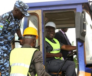 Abia state Governor, Dr. Okezie Ikpeazu test running one of the equipments to flag-of some roads for construction in Aba.