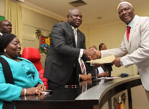 Lagos State Governor, Mr. Akinwunmi Ambode (2nd left) congratulating the Chairman, Governing Board, Lagos State Polytechnic, Ikorodu, Prof. Tajudeen Gbadamosi during the inauguration of the Governing Council of tertiary institutions in the State at the Lagos House, Ikeja, on Tuesday, September 22, 2015. With them is the Deputy Governor, Dr. (Mrs.) Oluranti Adebule.