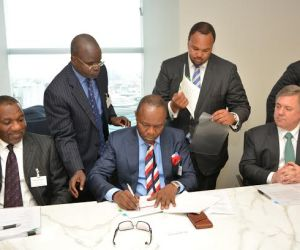 (L-R) Mr.Isiaka Abdul-Razaq, Group Executive Director, Finance and Services, Nigerian National Petroleum Corporation, Dr. Ibe Kachikwu Group Managing Director, NNPC and Mr. Clay Neff at the Signing-Ceremony of the $1.2 billion Alternative Funding Arrangement package