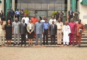 The governor of Enugu State, Rt. Hon. Ifeanyi Ugwuanyi(middle), flanked by members of the boundary committee at Government House, Enugu