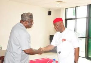 Governor Ifeanyi Ugwuanyi of Enugu state (left) in a hand shake with a former Nigerian Minister of State for Foreign Affairs, Chief Dubem Onyia when Ngwo Udi Local Government Stakeholders and Leadership Forum paid him a courtesy call at the Government House Enugu.