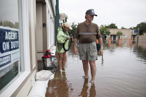 Chuck Richardson and his wife Ginger arrive to inspect their flooded Front Street office building in Georgetown, South Carolina October 4, 2015. REUTERS/Randall Hill