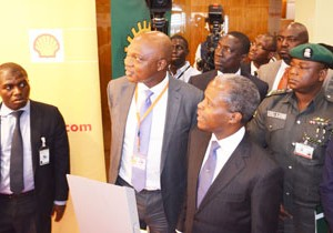 Managing Director of The Shell Petroleum Development Company of Nigeria Ltd (SPDC) conducts Nigeria's Vice President, Prof. 'Yemi Osinbajo at the exhibition stand of the company at the 21st Nigeria Economic Summit in Abuja.