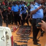 (Photonews) Police parade arms, ammunition seized from fleeing Igarra banks' robbers