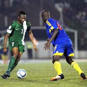 Super Eagles captain, Ahmed Musa attempts to go past a Swaziland player in Tuesday's match in Port Harcourt