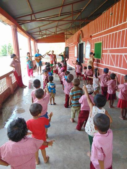 Students at the Wolfgang Linke Kindergarten sing along and dance as one of our volunteers,@Wesley Chambers, leads songs during music time. Wesley is a junior at BSC majoring in music education.