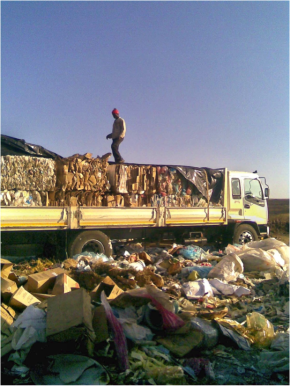 Bales of cardboard and plastic being loaded onto a truck to be recycled. Photo: groundWork