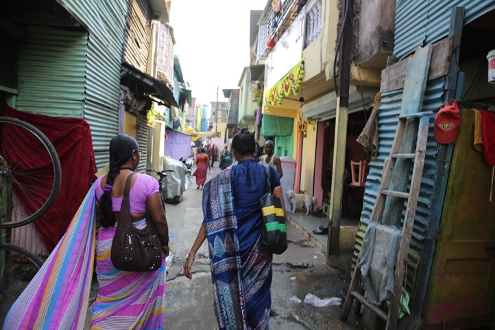 Bapu Trust workers walk through the slums, looking for people who need assistance.