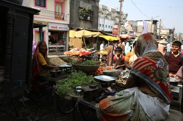 Vendors sell fruits and vegetables in the slums.
