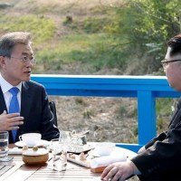 North and South Korean leaders, Kim Jong Un and Moon Jae-in have tea while at a meeting in April 2018
