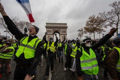 "PARIS, FRANCE - DECEMBER 01: Clashs between police nad Gilets Jaune on Place de l'Etoile, December 1, 2018 in Paris, France. The demonstrators, known as ""gilets jaunes"" or ""yellow vests,"" have protested across France for the last two weeks, demanding a reduction in fuel prices. French law requires drivers to carry yellow vests in case of accident. (Photo by Veronique de Viguerie/Getty Images)"