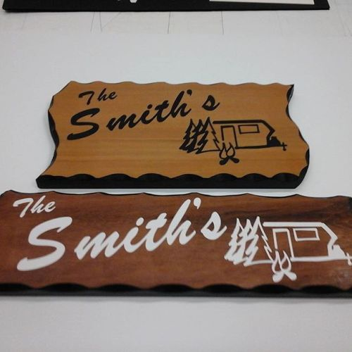 Wood signs with black or white letters