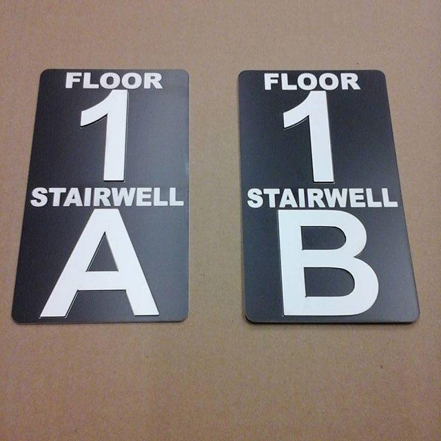 Laser stairwell signs