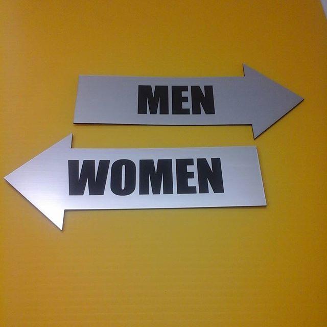 Lasered washroom signs