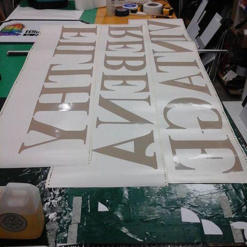 Reverse cut vinyl lettering