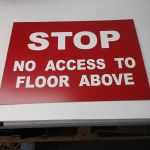 Lasered door sign