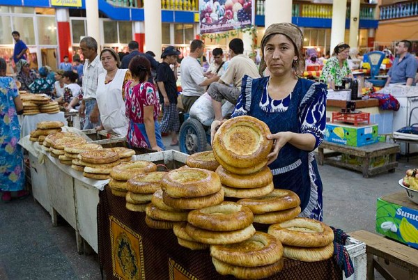Tajik woman selling bread on a market. Photo by Steve Evans.