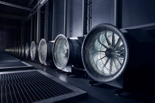 These enormous fans draw in the outside air to cool the tens of thousands of servers in the data hall. In the winter, when temperatures plunge to -30 degrees the situation is reversed, and the heat from the servers warm the massive buildings.