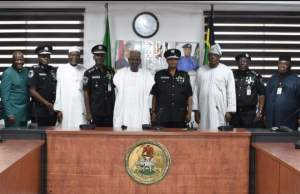 The IGP of police, Usman Baba Alkali, in a group photograph with officials of the FCTA led by the minister of FCT, Muhammad Musa Bello, during courtesy call on the IGP at the force headquarters in Abuja on Wednesday
