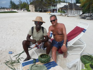 """Very skilled vendor who made baskets, hats and beach bags from palm leaves."""