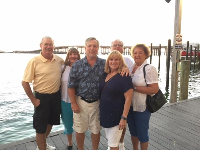 """Global allowed us to travel to our son's wedding with our lifelong friends. Photo taken at Harborwalk in Destin, Florida."""
