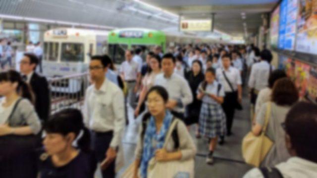 a commuter rail station in suburban tokyo