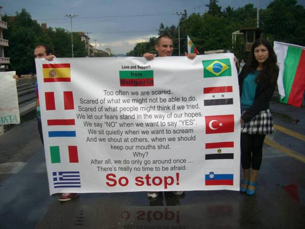 Bulgarian protesters show solidarity with fellow protesters in other countries; image meme courtesy of Revolution News.