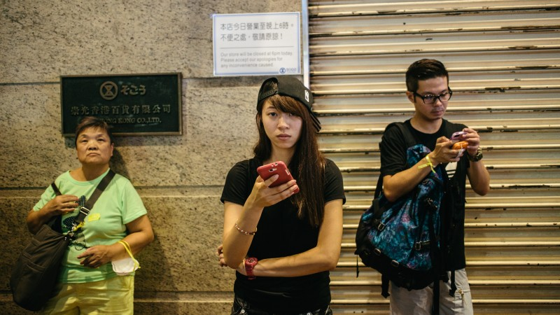 Students gathered in numbers on September 29 outside Sogo Department store in Hong Kong's Causeway Bay to continue the fight for democracy in what being called the Umbrella Revolution. Photo by Pete Walker. Copyright Demotix