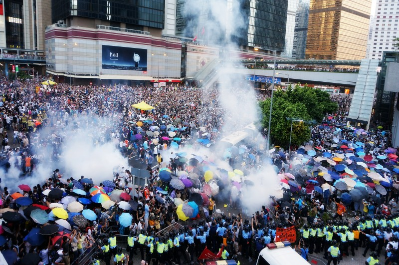 Protesters in Hong Kong stand together after police begin to tear gas the gathering on September 28. Photo by P H Yang. Copyright Demotix