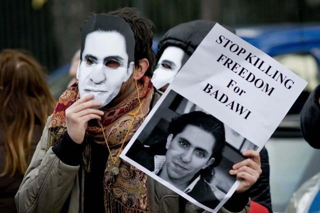 Rome, Italy. 9th January 2014 -- Protestors with masks of Raif Badaw, protesting against the request of the death penalty and calling for the release of blogger. -- Sit-in in front of the Embassy of Saudi Arabia to protest against the flogging and ask for the immediate release of journalist and blogger Saudi Raif Badawi imprisoned on charges of apostasy. Photograph by Stefano Montesi. Copyright: Demotix