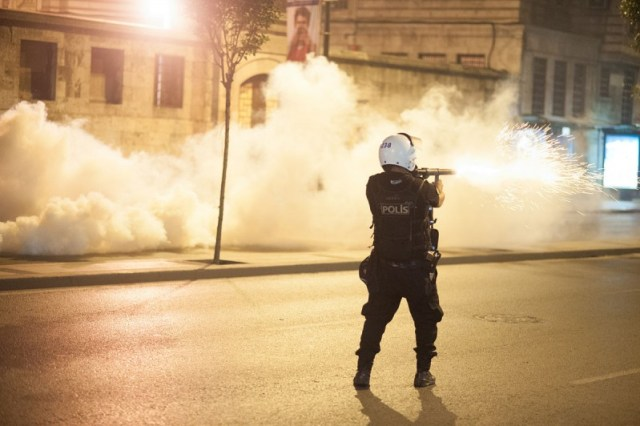 A police officer fires teargas in Istanbul during the Gezi Park protests, June 2013. Photo by Mstyslav Chernov via Wikimedia (CC BY-SA 3.0)