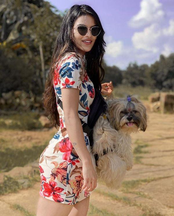 Unika Ray with Her Dog