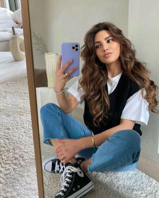 Negin Mirsalehi with iPhone