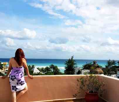 photo of me looking out on Caribbean taken with my tripod in Playa del Carmen