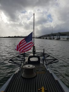 US flag flying at half mast on board the USS Bowfin at Pearl Harbor Hawaii
